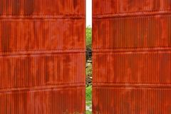 Rusty corrugated metal red wall and gate Royalty Free Stock Image