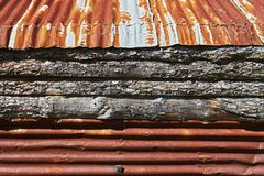Rusty corrugated metal roof and pine wood panels royalty free stock image