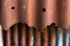 Rusty corrugatediron. Close-up of the rusty corrugated iron of and old building at Chonburi Province in Thailand stock photos