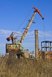 Rusty crane on abandoned factory Royalty Free Stock Images