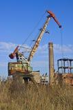 Rusty crane on abandoned factory. Suburb Arshintsevo near Kerch, Ukraine Royalty Free Stock Images