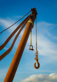 Rusty crane and blue sky. Rusty crane towards the blue sky stock images