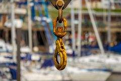 A rusty crane hook with blurry background. Of Bridlington harbour, East Riding of Yorkshire, UK royalty free stock photography