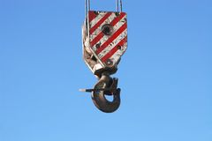 Rusty crane hook hanging on blue sky Royalty Free Stock Images