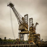 Rusty cranes at Battersea power station Royalty Free Stock Images
