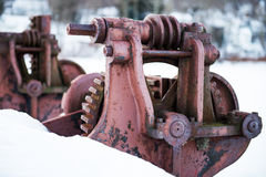 Rusty Dam Wheel #2. Rusted red dam mechanism in winter snow Royalty Free Stock Photo