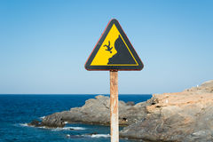 Rusty Danger Cliff Sign in Cabo de Palos Fotografie Stock
