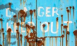 Rusty Danger Keep Out Doors foto de archivo