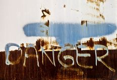 Rusty Danger Sign Stock Images