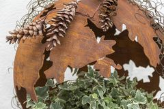 Rusty decoration detail. Decoration detail including a fragmented rusty bowl and ivy plant Stock Images