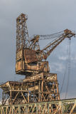 A rusty, derelict crane. At the abandoned Battersea power station, London, UK Royalty Free Stock Image