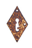 Rusty diamond shaped keyhole isolated. Rusty diamond shaped keyhole with missing screws on isolated background Royalty Free Stock Photography