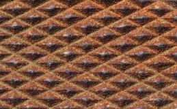 Rusty Diamonds. A pattern of rusted diamond shapes Stock Photo
