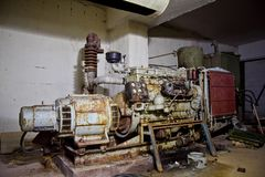 Rusty diesel generator in an abandoned Soviet bomb shelter Royalty Free Stock Photo