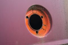 Rusty gasoline filler cap of a vintage car. Rusty and dirty gasoline filler cap of a vintage car in retro design Royalty Free Stock Images