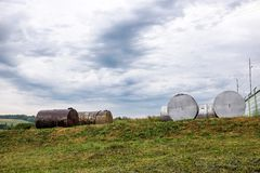 Rusty discarded tanks out in a field Royalty Free Stock Image