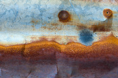 Rusty and distorted galvanized iron. Background Stock Image