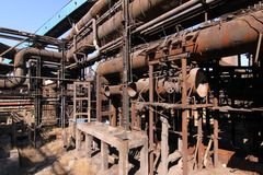 Rusty disused steel plant pipes Stock Image