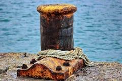 Rusty dock bollard Stock Images