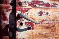 Rusty door. Curious detail of an old rusty door of an old vehicle Stock Photos