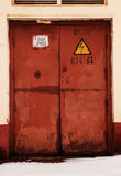 Rusty door, danger high voltage Stock Images