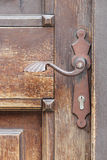 Rusty door handle and old door Stock Photo