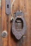 Rusty door handle on an old wooden door Royalty Free Stock Images