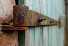 Rusty door hinge. An old door hinge at a farm stock images