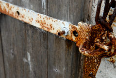 Rusty door hinge. An old door hinge at farm Royalty Free Stock Photos
