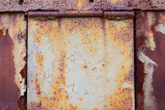 Rusty door with hinges. Old rusty door with hinges for background and design royalty free stock image