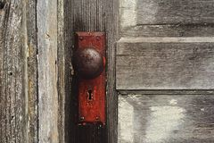 Rusty door knob on wooden door