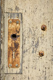 Rusty door mounting on wood Stock Photo