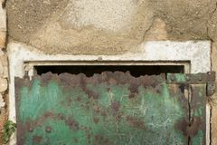 Rusty door. Outer counter door rusted by the passage of time royalty free stock image