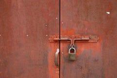 Rusty door with padlock Royalty Free Stock Image