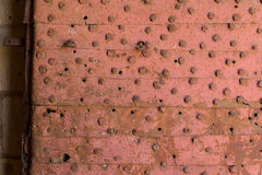Rusty door. Riveted with nails, barring the entrance of Tripoli& x27;s citadel Stock Images
