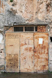 Rusty door in rock Stock Image