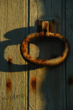 Rusty Doorknocker with shadow Stock Photo