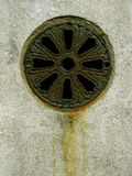 RUSTY DRAIN. Set within a wall Stock Images