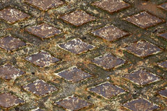 Rusty drain cover background Royalty Free Stock Image