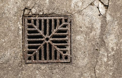 Rusty drain grate. Close up shot of a rusty drain grate royalty free stock images