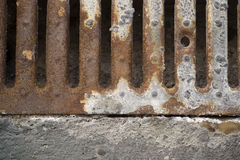 Rusty drain grate Royalty Free Stock Photography