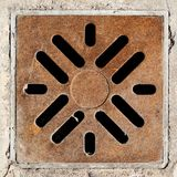 Rusty drain grate in concrete floor Stock Photos