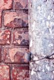 Rusty drain pipe with coiled wire on red brick wall close up detail. Grunge texture stock photography