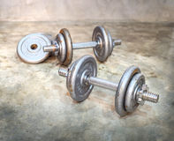 Rusty dumbbells. On the floor Stock Photography