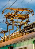 Electrical components of a vintage, still functioning, electrical train in Havana, Cuba. Rusty, Electrical components of a vintage, still functioning, electrical stock image