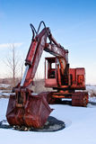 Rusty Excavator. A view of an old rusty excavator in the snow Stock Photography
