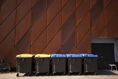 Rusty facade and garbage bins Royalty Free Stock Images