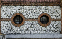 Rusty  facade with round windows Stock Image