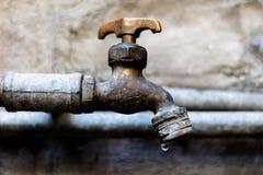 Rusty facet leaking 1. Water leak on rusty facet stock image