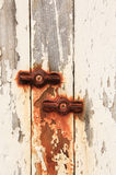 Rusty fasteners. Rusty wing nuts with peeling white paint Stock Photo